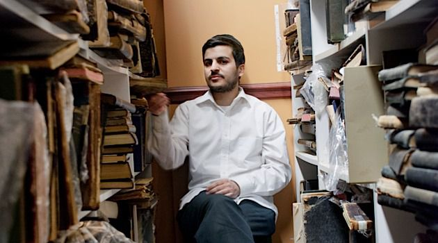 Young Man With Old Books: 28-year-old Yisrael Mizrachi is the proprietor of the Mizrachi Bookstore in Marine Park.