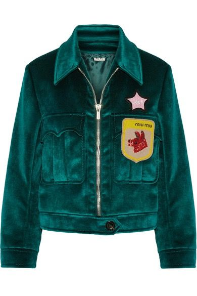 """An emerald green velour jacket with a collegiate patch underneath a pink """"Jack"""" star."""