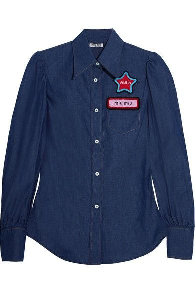 """A chambray blouson-sleeve button-down with a red star """"Alain"""" patch and """"miu miu"""" name tag patch."""