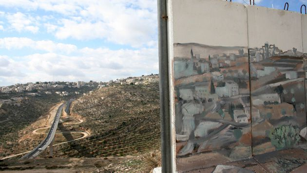 Beyond These Walls: A barrier, built to protect the Jerusalem neighborhood of Gilo from Palestinian gunfire, features a mural of the scenery beyond it.