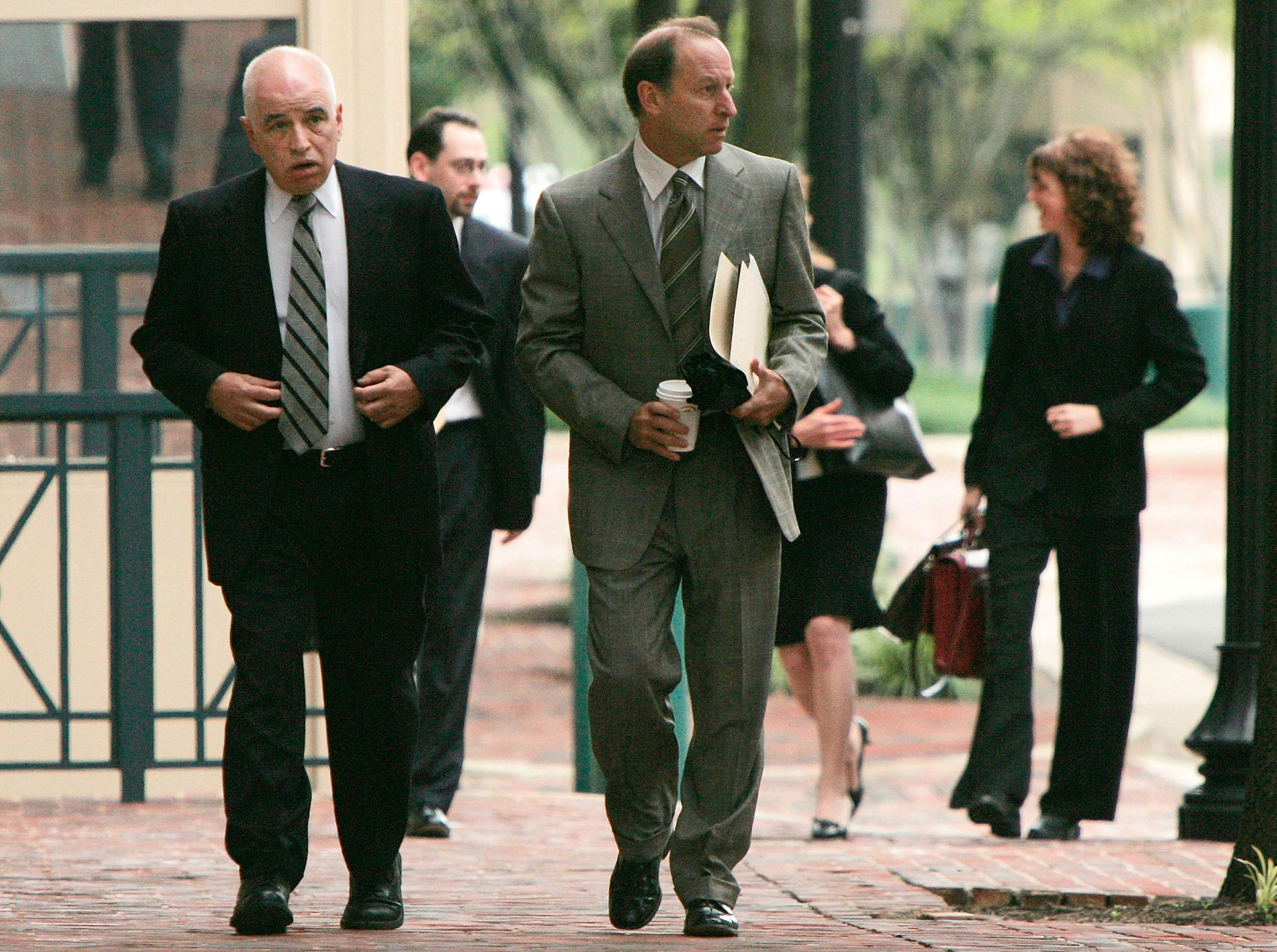 For the Defense:Abbe Lowell (right) accompanies ex-AIPAC official Steven Rosen from the courtroom in 2005.