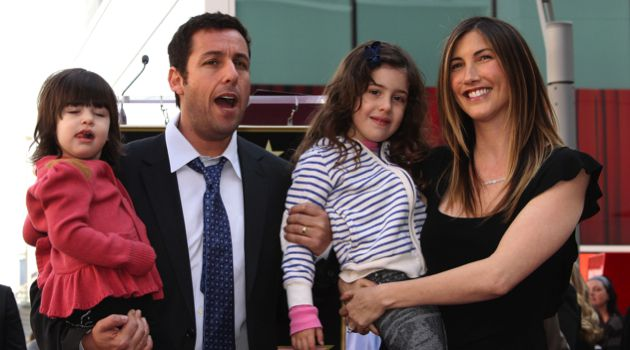 Hollywood Dad: Adam and Jackie Sandler hug children Sadie and Sunny.