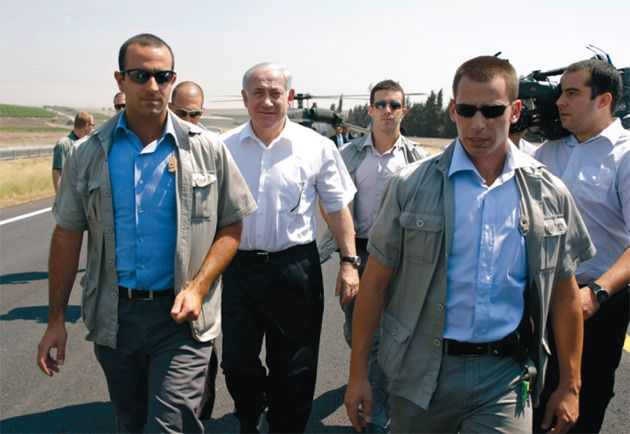 Advocate For Privatization: Benjamin Netanyahu, center, with security guards in northern Israel on July 20.