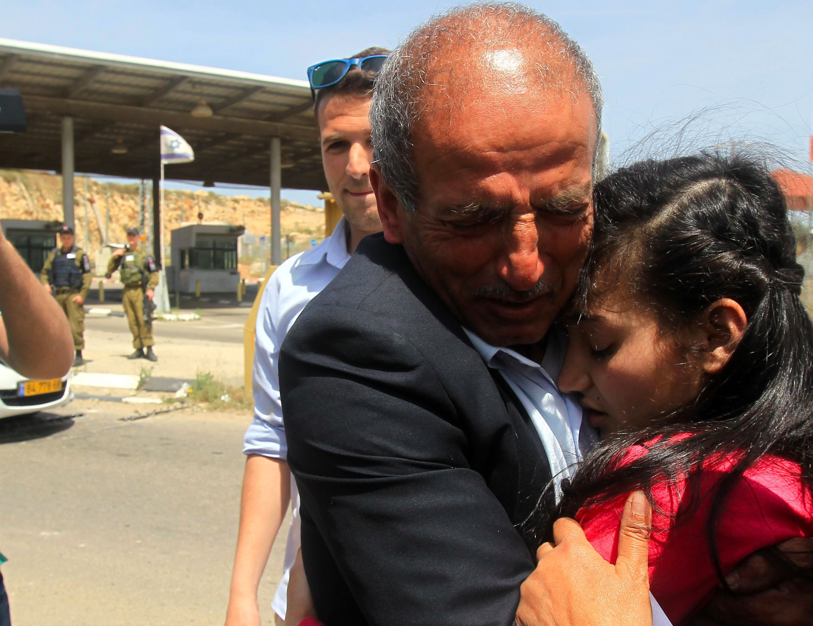 Ismail Al Wawi embraces his 12-year-old daughter Dima Al Wawi upon her release from Israeli prison.