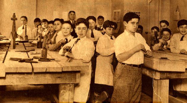 1930s: Boys at the Amalgamated Cooperative Houses, an affordable housing facility in the Bronx, N.Y., take part in a wood carving class.