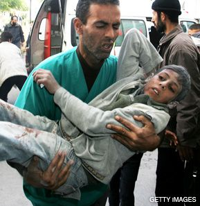 INJURED: A Palestinian medic carries a boy wounded in an Israeli airstrike into a hospital in Beit Lahia, in northern Gaza on January 14. Human rights groups allege that Israel has impeded the evacuation of the wounded who need medical attention. Israel claims it allows the injured access to hospitals.