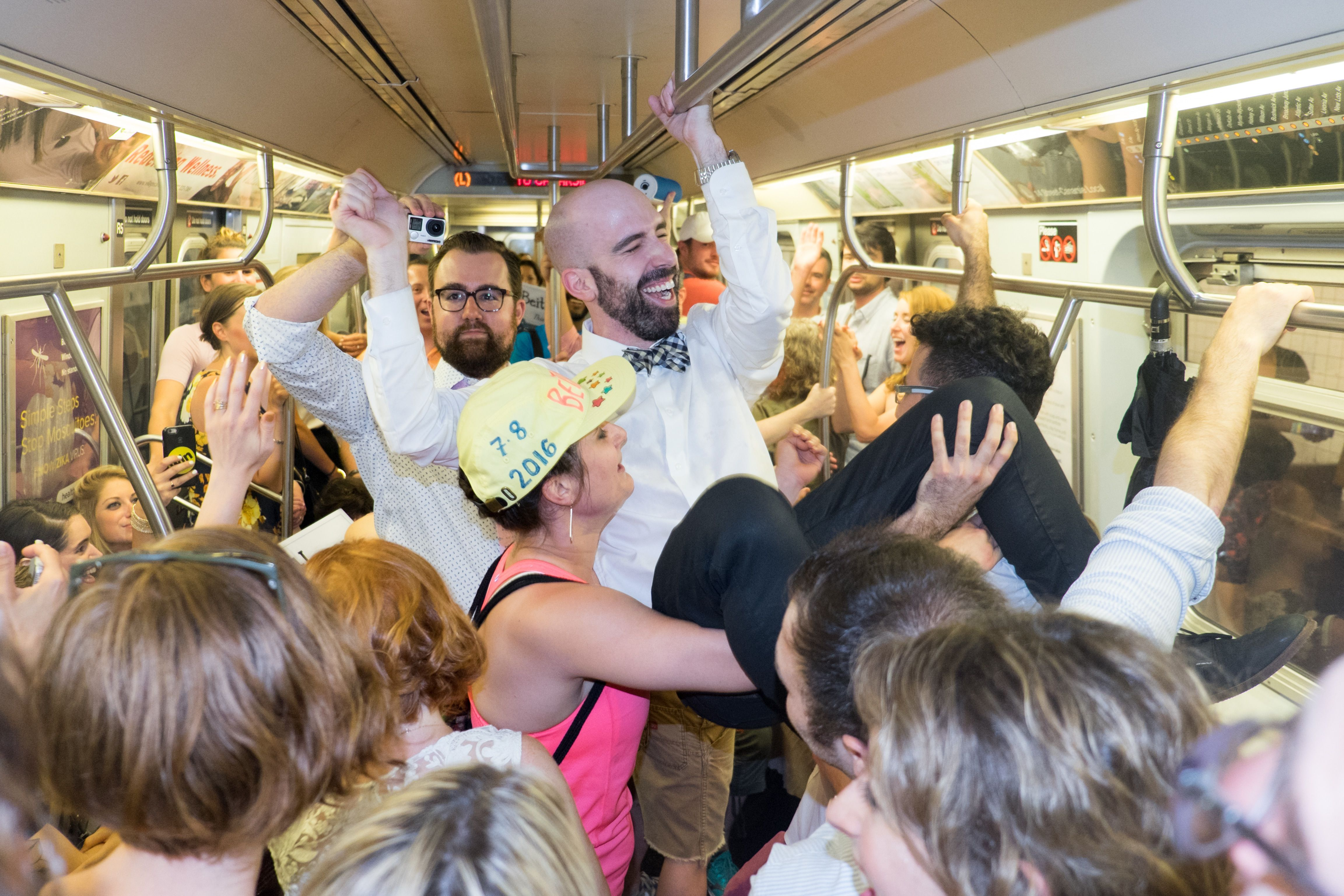 The groom does the hora on the subway.