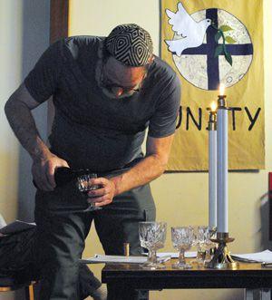 Cold Comfort: Engineer Dick Heyman pours wine for an Antarctic Sabbath service.