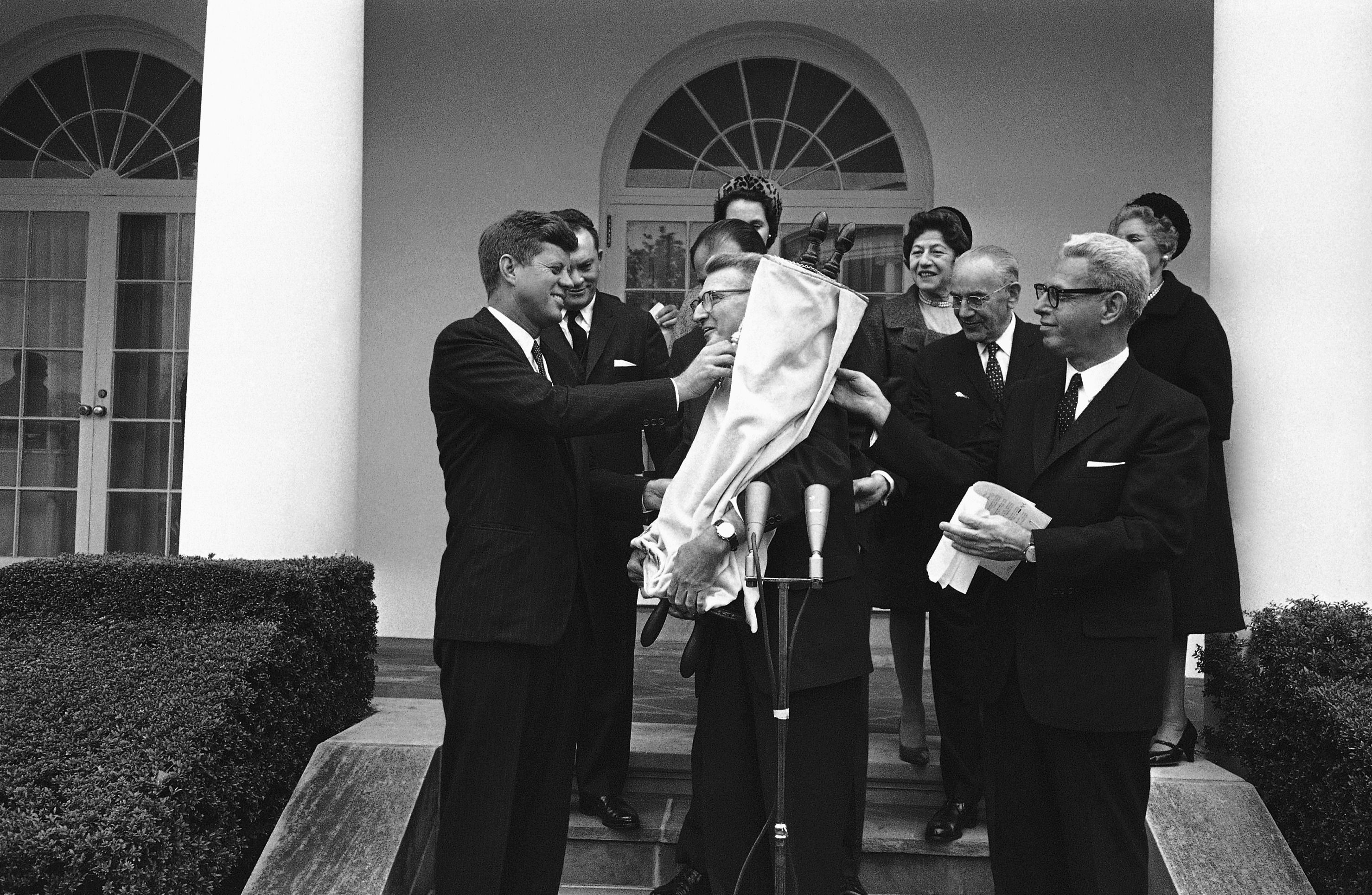 Thanks Jack:Members of the Religious Action Center present President John F. Kennedy with a Torah scroll to mark the founding of the group in 1961.