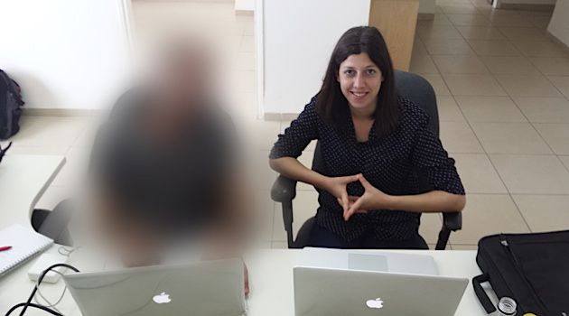Tomorrow's Tech Leaders? The Palestinian intern (left, with blurred face) and Hadar Farberman, the head of user experience and design at the Haifa-based start-up MediSafe. The intern could not reveal his identity, fearing repercussion from his community.