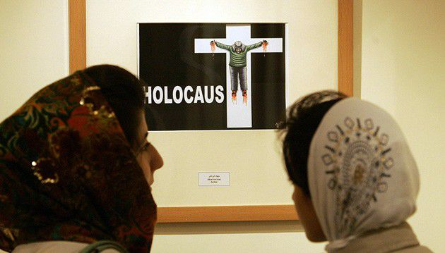 A cartoon of an Arab man crucified on a cross marked ?Holocaust? is displayed in a 2006 Holocaust cartoon exhibition in Tehran.