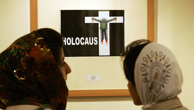 New Lows: A cartoon of an Arab man crucified on a cross marked ?Holocaust? is displayed in a 2006 Holocaust cartoon exhibtion in Tehran.