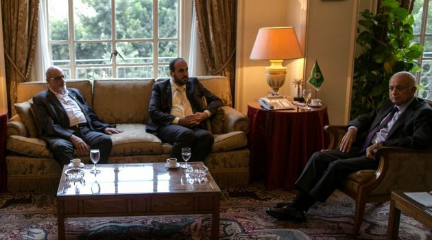 Syrian opposition figure and prominent Syrian human rights activist Haitham al-Maleh, left, and Secretary-General of the Syrian National Coalition Nasr al-Hariri, centre, meet with the Arab League's Secretary-General, Nabil al-Arabi, at their headquarters in Cairo.