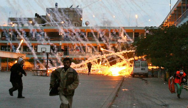 White Phosphorus: Israel?s new report states that shells containing the incendiary chemical were used only in ?open, unpopulated areas,? but ?unfortunately may have landed? at an elementary school in Beit Lahia. Critics say the photo of Palestinian civilians fleeing the school, above, belies the claim.