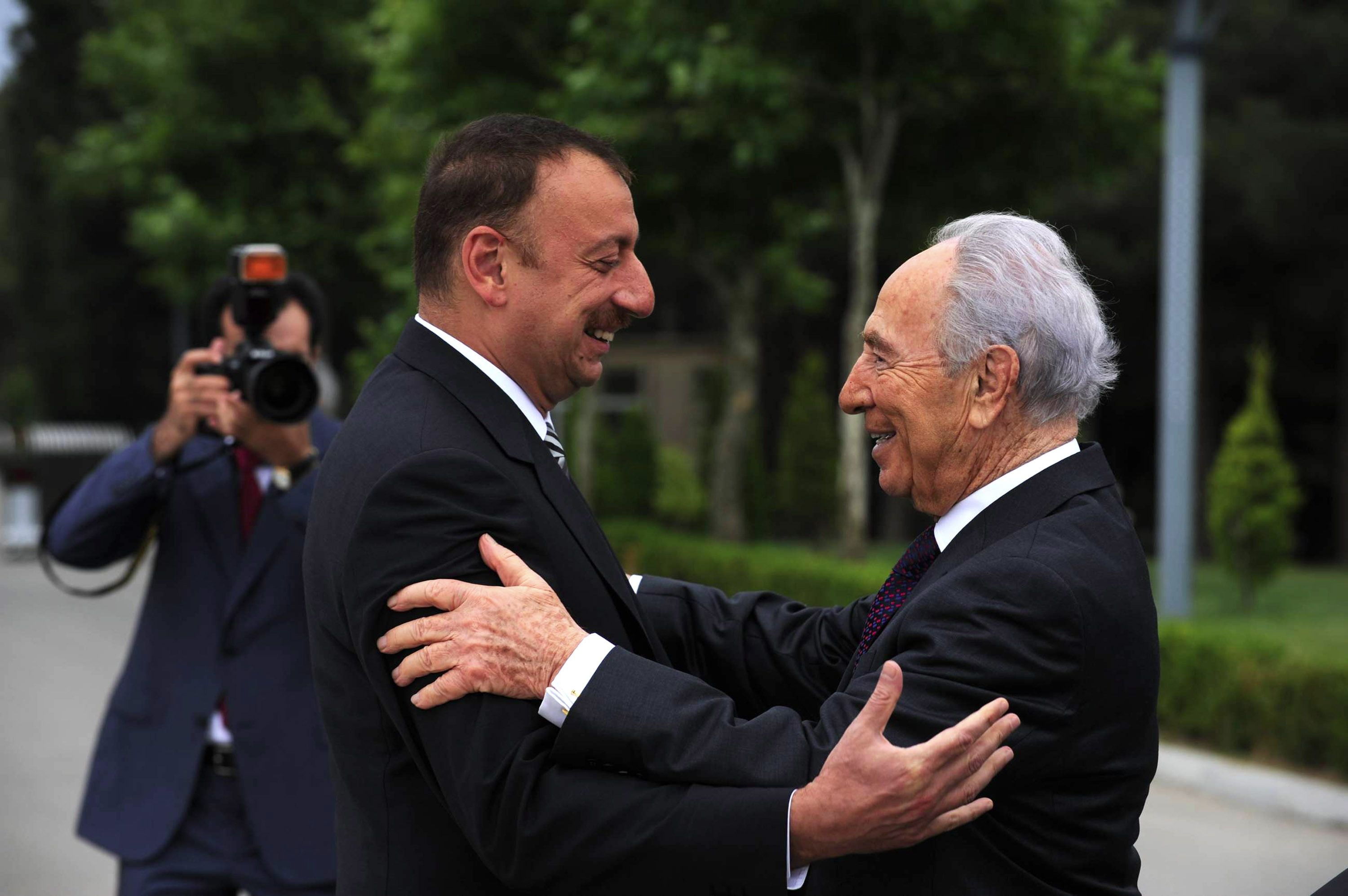 Israel's then president, Shimon Peres (right), embraces the president of Azerbaijan, Ilham Aliyev, on a visit in 2009.