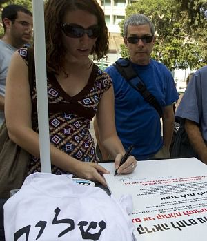 Israeli activists sign petition against a law criminalizing support of moves to boycott Israel or the West Bank.