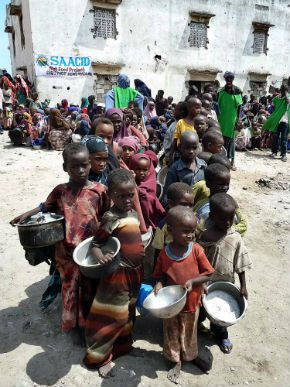Children line up for a meal in Mogadishu, where more than 100,000 people have fled to to seek help from a severe drought that has hit Somalia.