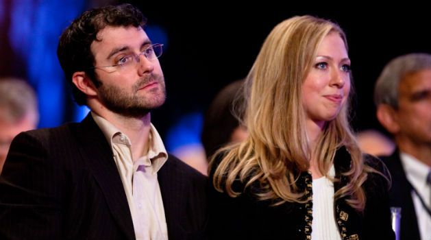 Anything for the In-Laws: Marc Mezvinsky sits with wife Chelsea Clinton during the closing Plenary session of the seventh Annual Meeting of the Clinton Global Initiative (CGI), which is run by her famous dad, Bill Clinton.