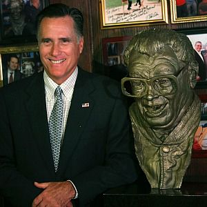 Who Knew? Mitt Romney, who posed with a statue of Chicago Cubs announcer Harry Caray, is no fan of the kibbutz.
