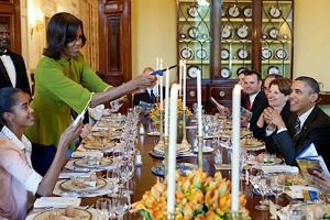 Welcoming Elijah: First Lady Michelle Obama lights candles to begin last year?s White House Seder.