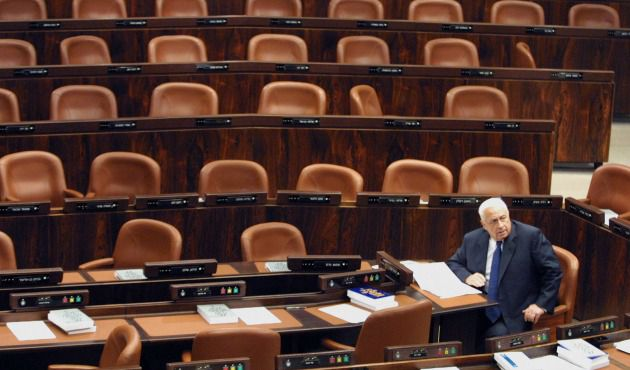 Ariel Sharon in Knesset, preparing his speech for the opening of the summer session, May 7, 2001.