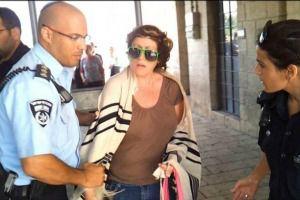 Deb Houben being taken away by the police.