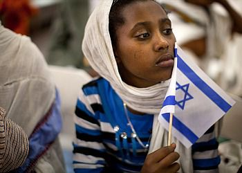 A new Jewish immigrant during a welcoming ceremony after arriving in Israel on a flight from Ethiopia.