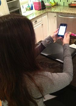 Journalist Nina Badzin sits in her kitchen checking her iPhone. Can she really give up her gadgets for a whole year?