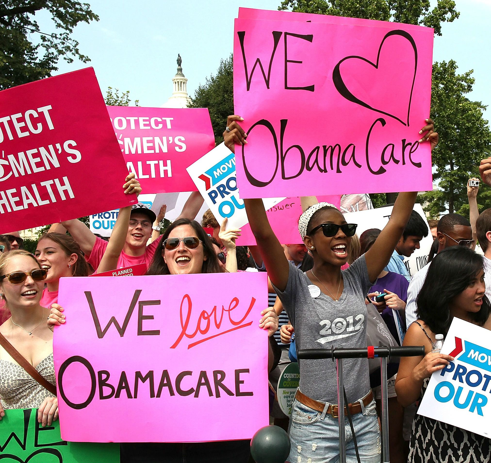 Obamacare supporters react to the U.S. Supreme Court decision to uphold President Obama?s health care law, on June 28, 2012 in Washington, DC.