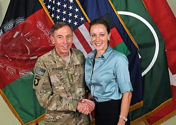 General Davis Petraeus shakes hands with biographer Paula Broadwell in 2011.