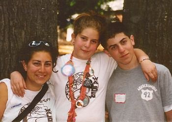 Caroline Rothstein (left) with her sister, Natalie, and brother, Joshua, in the summer of 2002, a year before he passed away.