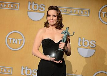 Tina Fey accepts a Screen Actors Guild Award for Outstanding Performance by a Female Actor in a Comedy Series.