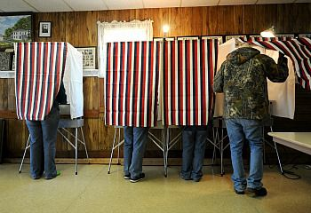 Voters cast their ballots in Macksburg, Iowa.
