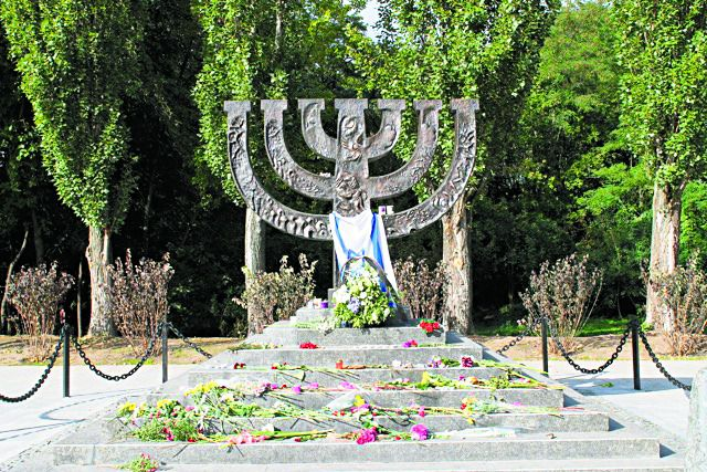 A menorah is one of several commemorative symbols at the site of Babi Yar.