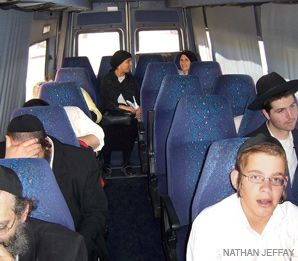 OUT OF SIGHT: Women keep to the back of a bus from Or Akiva to Bnei Brak.