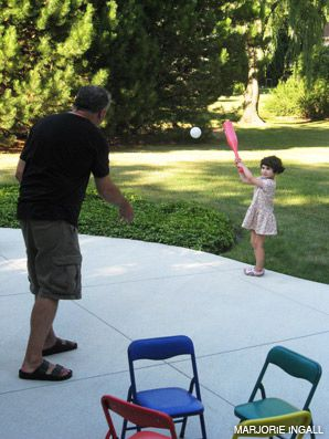 UP AT BAT: Maxine, 3, practiced her swing this summer.