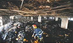 Horror: The aftermath of the fire at Ha-Meem Group garment factory in Bangladesh, which took the lives of 29 workers.