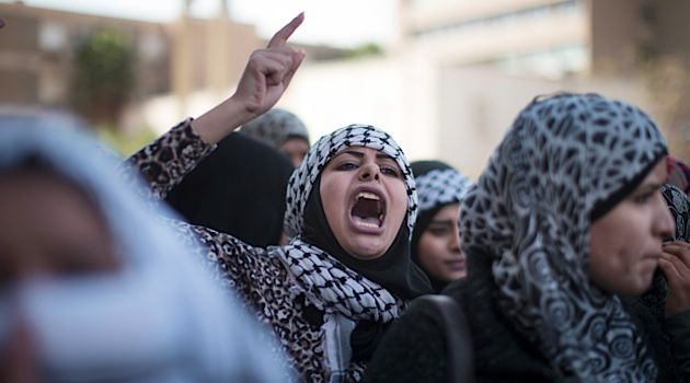 An Arab woman joins a protest against Israel?s ?Prawer Plan? which will relocate 40,000 Bedouins from their traditional villages to towns.