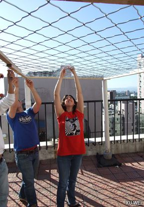 GROUP EFFORT: Young Jews worked together to put up a rooftop Sukkah in Beijing.