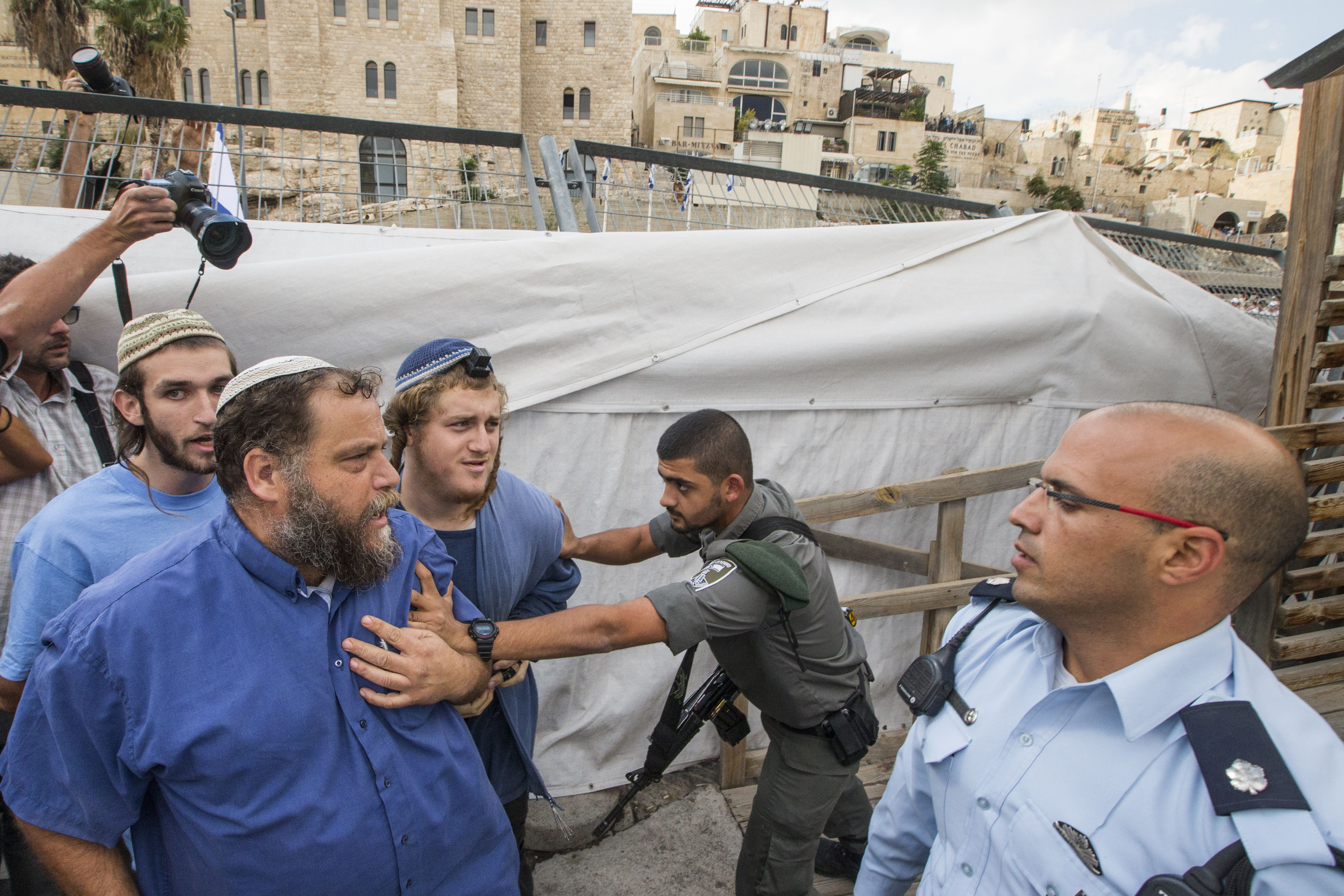 Bentzi Gopstein is pushed back by a border guard in 2014.