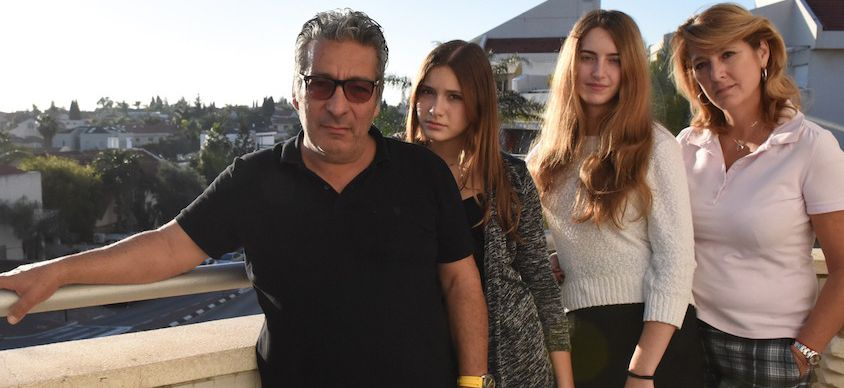 Catherine Berdah, right, with her husband and daughters in their apartment in Ra'anana, Israel.