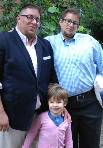 S. Bear Bergman (left) and his husband j and son Stanley.