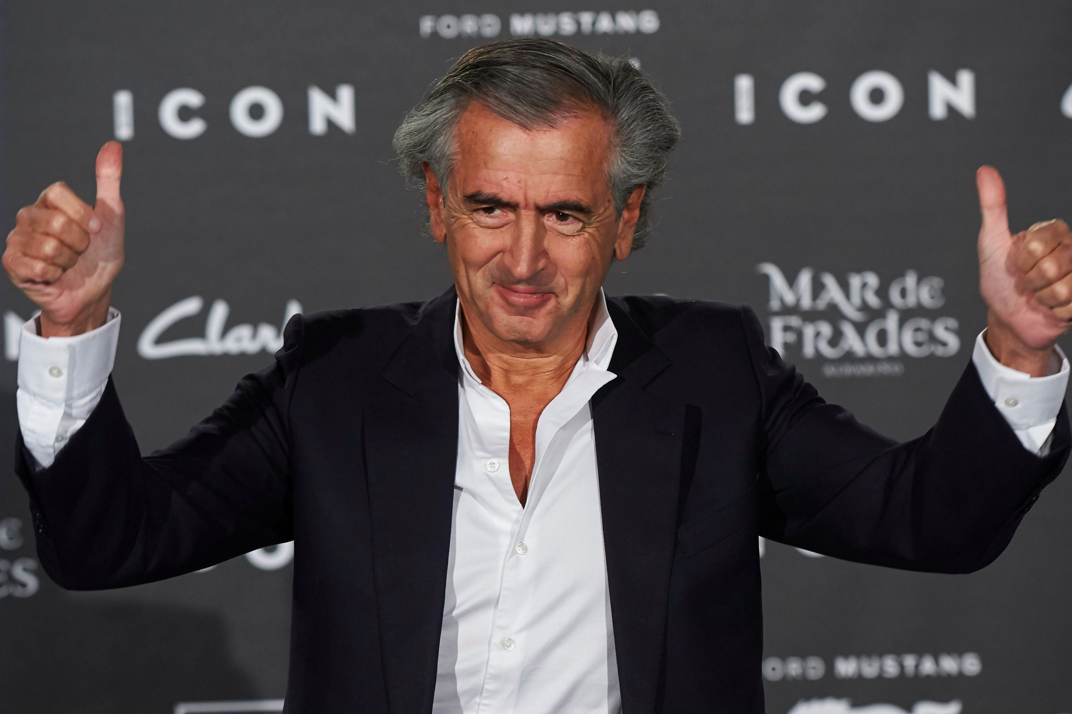 Bernard-Henri Lévy in his iconic white shirt.