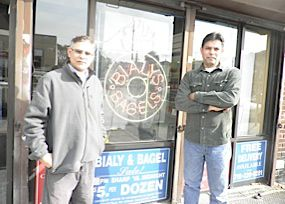 Zafaryab Ali andPeerzada Shah pose outside their new shop.