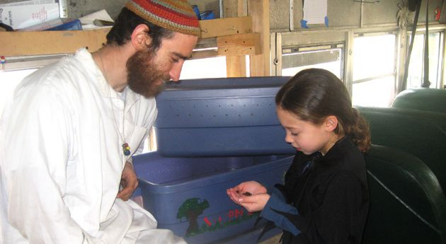 Mobile Classroom: An educator and a student aboard the Topsy-Turvy Bus, participating in the Teva Learning Center?s Jewish environmental program.