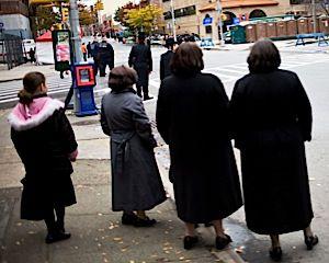 Ultra-Orthodox women and girls in Williamsburg watch the New York City marathon.