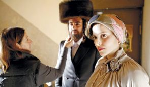 Actors Renana Raz ?(right?) and Yiftach Klein on the set of Burstein?s ?Filling the Void.?