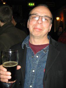 Michael Wex with his favorite beer, Old Peculier.