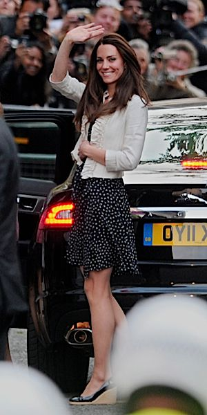 Princess-to-be Kate Middleton waves to crowds of royal-watchers on the day before her wedding to Prince William. (click to enlarge)