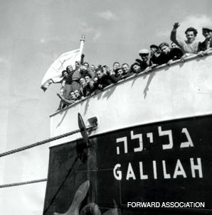 HOME: After a 12-hour journey from Cyprus, Jewish refugees arrive in Haifa, where crowds greet them.